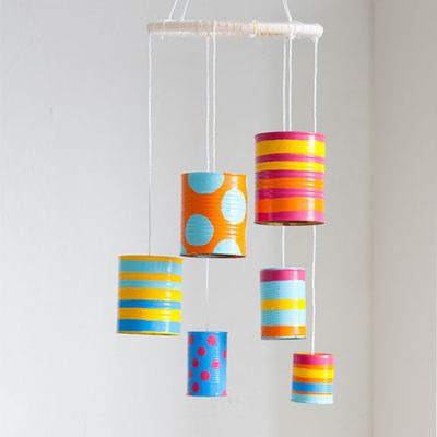 #DIY Tin-Can Wind Chime: This beautiful #craft is a great way to let little ones explore their creativity, while making something thats a treat for the ears and eyes.