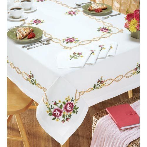 "Village Linens Heirloom Rose Table Runner Stamped Embroidery by Village Linens. $11.99. Soft pink and red roses that are sure to add some elegant sophistication to your decor. Stamped for embroidery on fine quality, easy-care white 100% polyester fabric with a finished edge. Includes instructions. Approximately 14 x 44"" (36 x 112cm) table runner. Imported."
