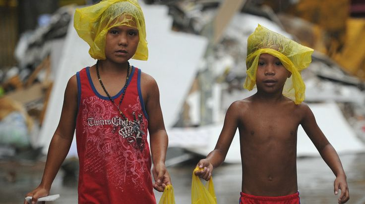 Young survivors of Typhoon Haiyan brave December rain as they ask for gifts from residents in the streets of Tacloban, the Philippines. From the NPR World Story of the Day for Monday, January 27