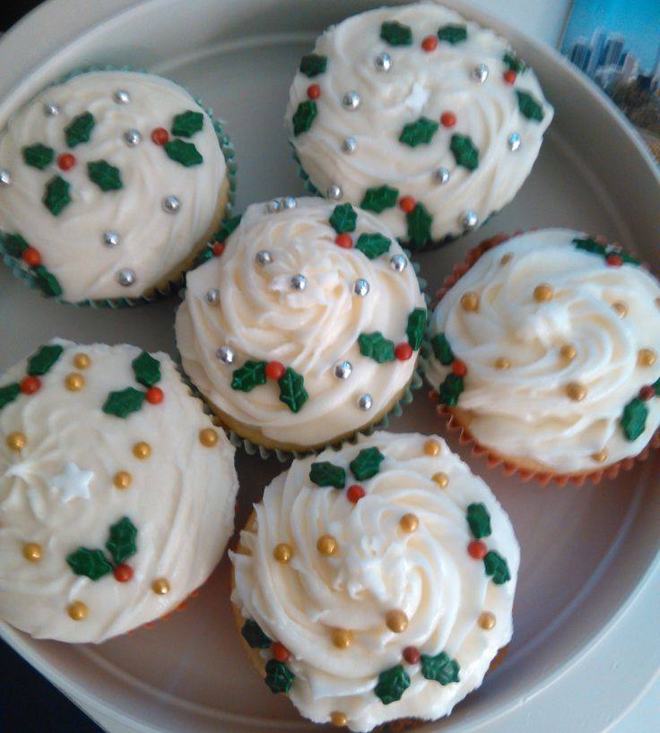 Christmas Cupcake - butter cupcakes with buttercream icing and holly, silver and gold  sprinkles.