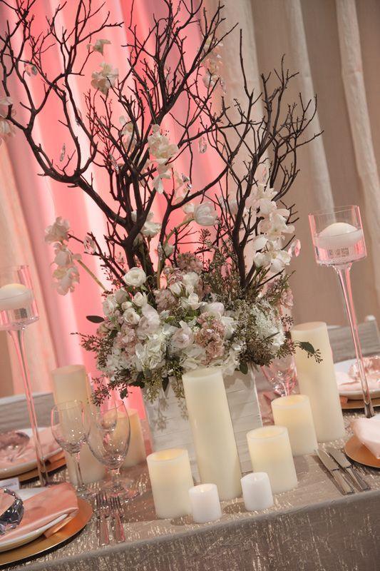Enchanted Florist Las Vegas- Manzanitta Branches with lush florals an cadles.