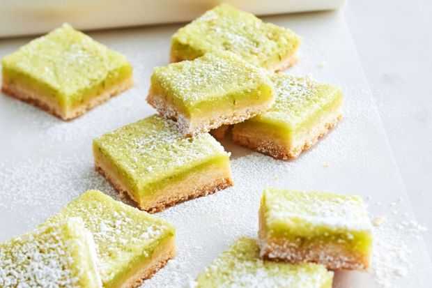 If you love the taste of classic sweet and tangy lemon squares, you'll love this lime version. The green food colouring darkens as the squares bake, so make the shade of the lime curd slightly lighter than your desired final colour.