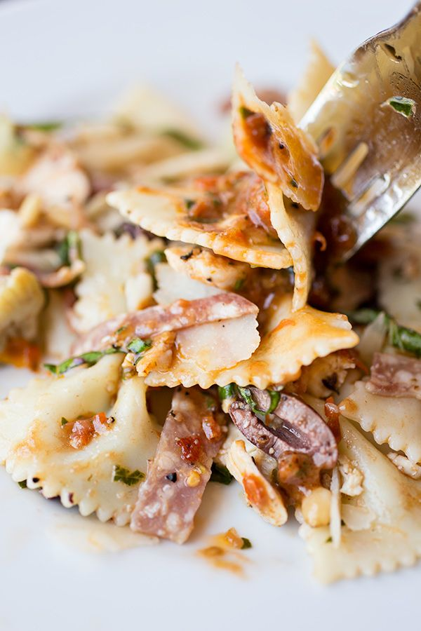 """""""The Fiery Italian"""" Pasta Salad in a Spicy, Tomato-Basil Vinaigrette, with Shaved Parmesan, Dry Salami, Grilled Chicken, Artichoke Hearts and Toasted Pine Nuts"""