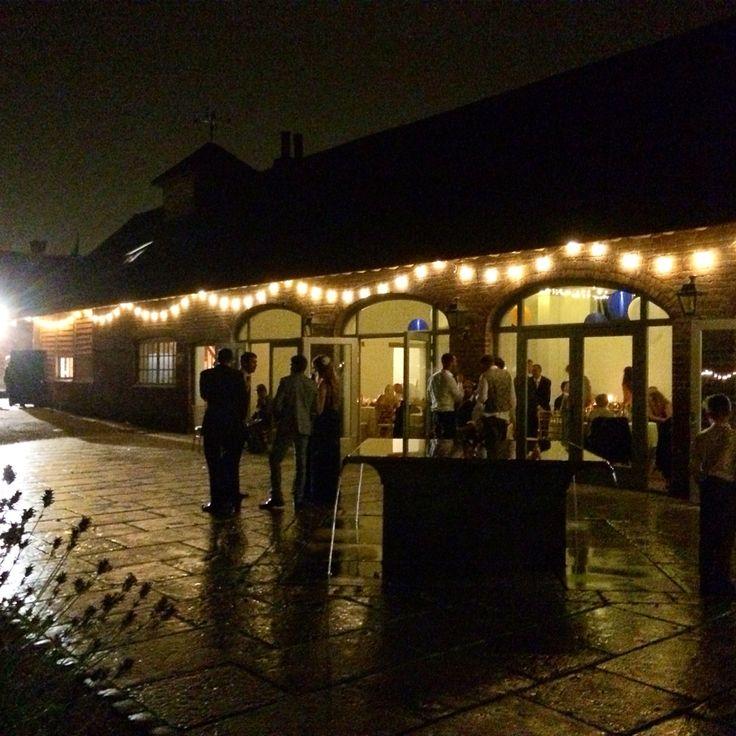 Festoon lighting courtyard at Dorney Court. Coach House Barn  http://www.lexmarqueehire.co.uk/dorney-court-wedding