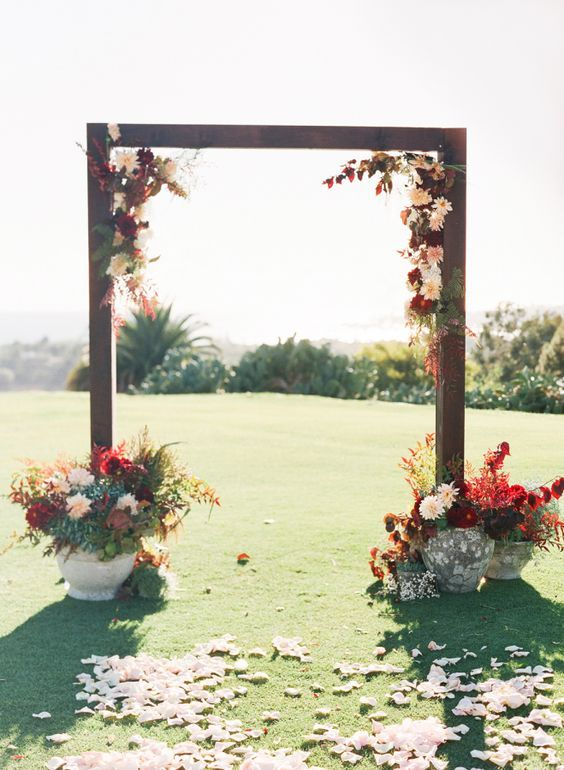 Fall floral-adorned wedding arbor / http://www.himisspuff.com/fall-wedding-arch-and-altar-ideas/2/