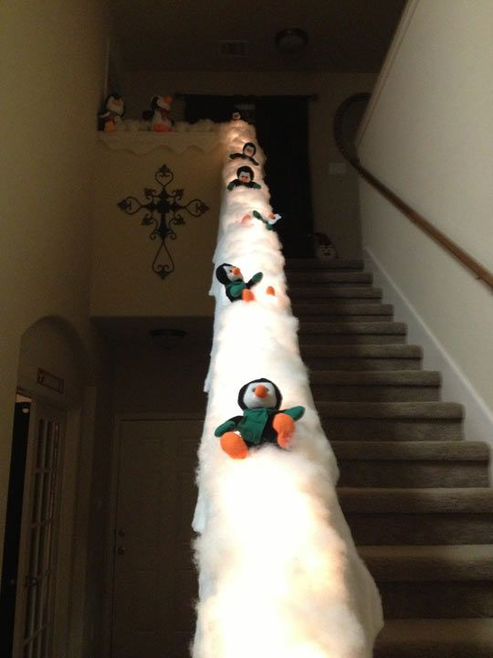 Turn your banister into a penguin slide… This might be the greatest Christmas decoration of all time.