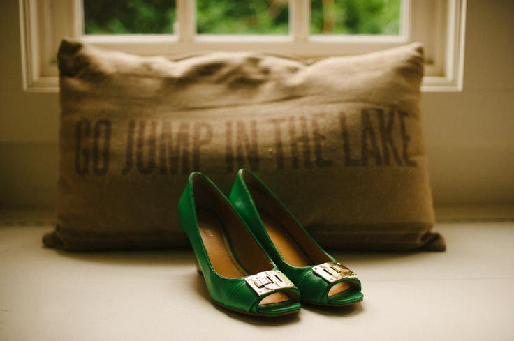 "Green wedding shoes on a ""Go jump in the lake"" pillow! What is not to love in this picture? Gorgeous summercamp wedding at Camp Wayfarer, in Flat Rock North Carolina, USA. More here: http://www.fotografamos.com/2014/11/26/summercamp-wedding-photographer-north-carolina-susannah-jacob/"
