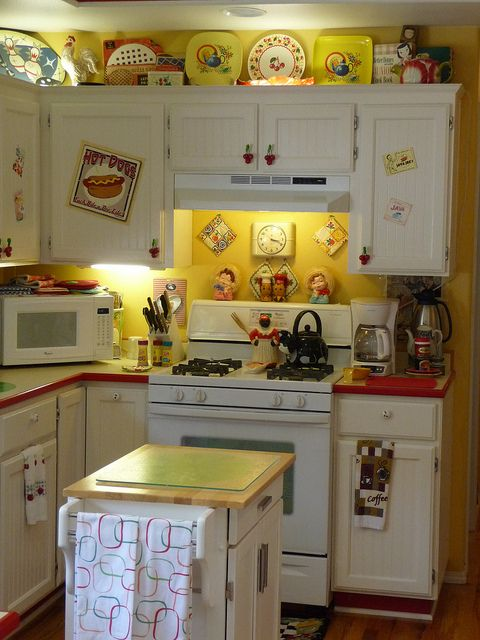 Retro yellow and red kitchen.  My mother had a Canary Yellow & Chinese Red  kitchen.
