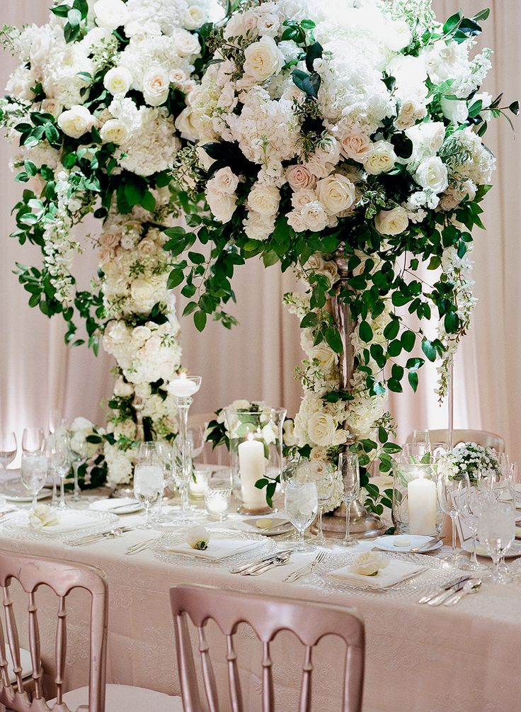 Floral wedding arch centerpiece: A Glamorous Meets Classic Wedding in Chicago