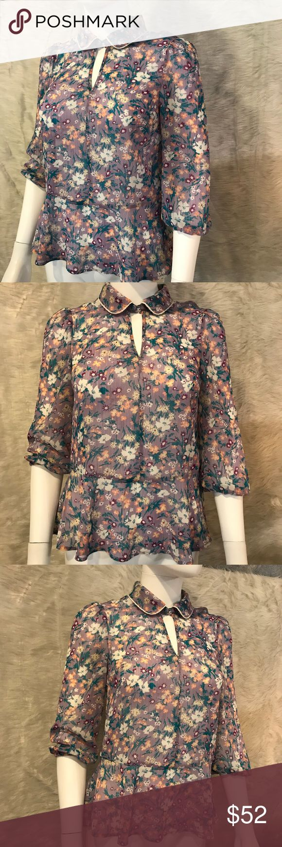 MODCLOTH floral lavender blouse top XXS ModCloth brand. Size XXS. The button looks loose as pictured, but feels secure when buttoned.  A few snags in material as pictured. Measurements in pictures. Modcloth Tops Blouses