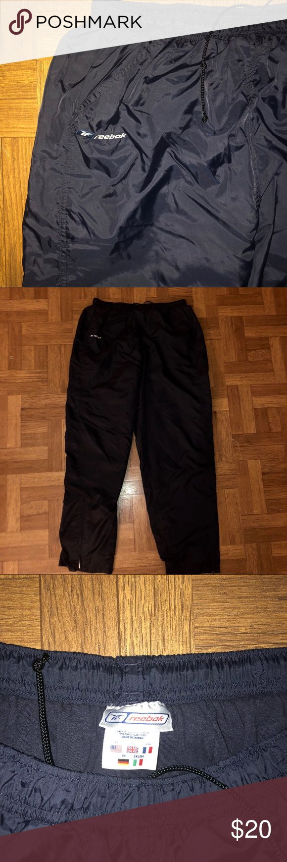 """""""Reebok"""" men's athletic pants size XL Dark Blue Athletic pants by """"Reebok"""", comfortable polyester/cotton material, """"Reebok"""" logo on upper right leg, adjustable waist and zippers at ankles for adjustable fit! In good condition! Reebok Pants Sweatpants & Joggers"""