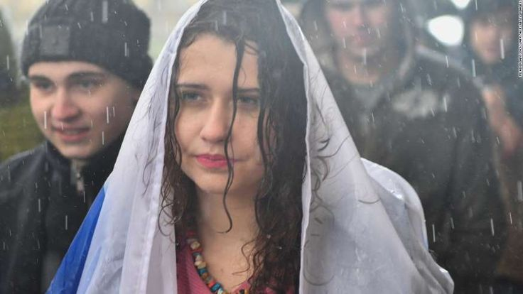290 arrests in anti-Putin march on Russian leader's birthday   -  October 8, 2017:    A woman protesting in the rain Saturday in support of jailed activist Alexei Navalny.