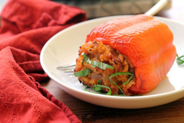 Arborio rice cooked in coconut milk and red curry paste makes a Thai-inspired filling for these stuffed peppers.