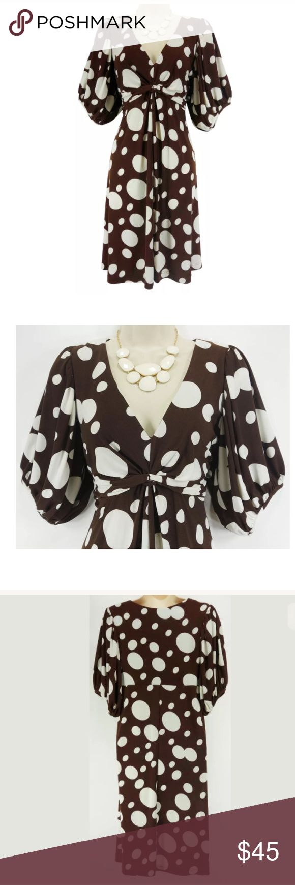 """14 Large XL CHOCOLATE/WHITE POLKA DOT DRESS Spring This sexy, sweet polka dot dress is perfect for a spring/summer occasion!   Size: 14 Slip on/off V-neckline Flattering ruched empire waist  Polka Dot print in chocolate & white Balloon elbow sleeves Stretchy, comfortable fabric Measurements: Bust (armpit to armpit): 38"""" relaxed - stretches to 46"""" Waist: 36"""" relaxed - stretches to 45"""" Hips: 46"""" relaxed Length: 38"""" (top of shoulder to bottom hem)  Condition:  PRISTINE CONDITION! Fabric…"""