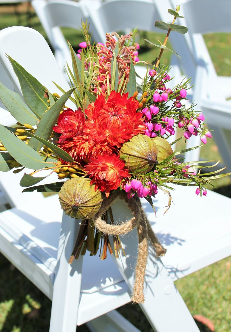 White House Flowers   wedding chair back posy of native red paper daisies, pink boronia, giant eucalyptus gum buds