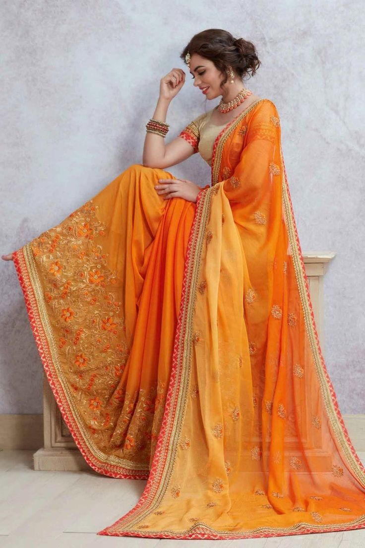 Glam up in festive parties and events with this beguiling orange color party wear designer saree. This beautiful georgette saree is decorated with heavy embroidery work. The saree comes along with matching unstitched raw silk blouse piece that can be cust
