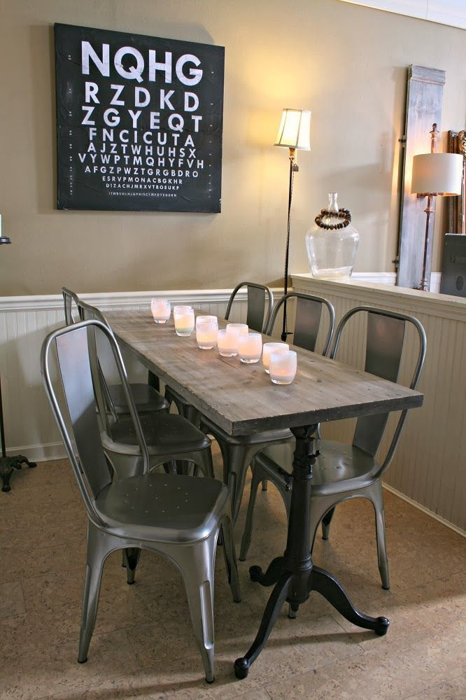Narrow Dining Table Masculine Letter Wall Decor And Metal Chairs