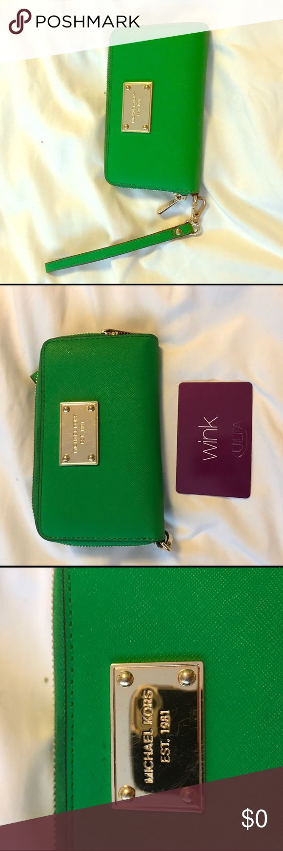 Michael Kors leather wristlet green Authentic, gently used. Slight scuffing on gold hardware but only noticeable upon close inspection.  3 credit card slots, room for bills, zipped coins, and phone (iPhone 6 & 7 fit, not the plus). Shown next to gift card to show how much bigger than a credit card the wristlet is. Has a wrist strap. Feel free to make an offer Michael Kors Bags Clutches & Wristlets