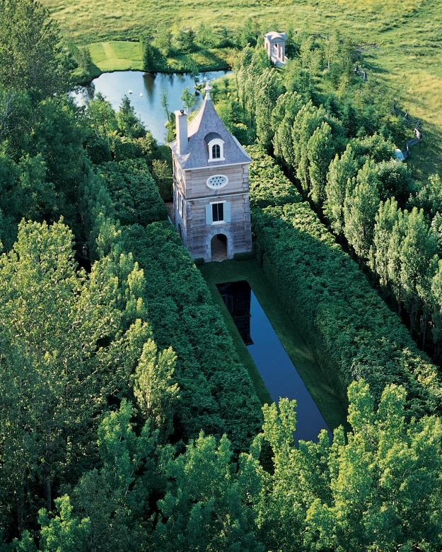 Photo by: Richard W. Brown At Les Quatre Vents, Cabot's masterpiece at his family home in Quebec, a pigeonnier offers a bird's-eye view of the garden.