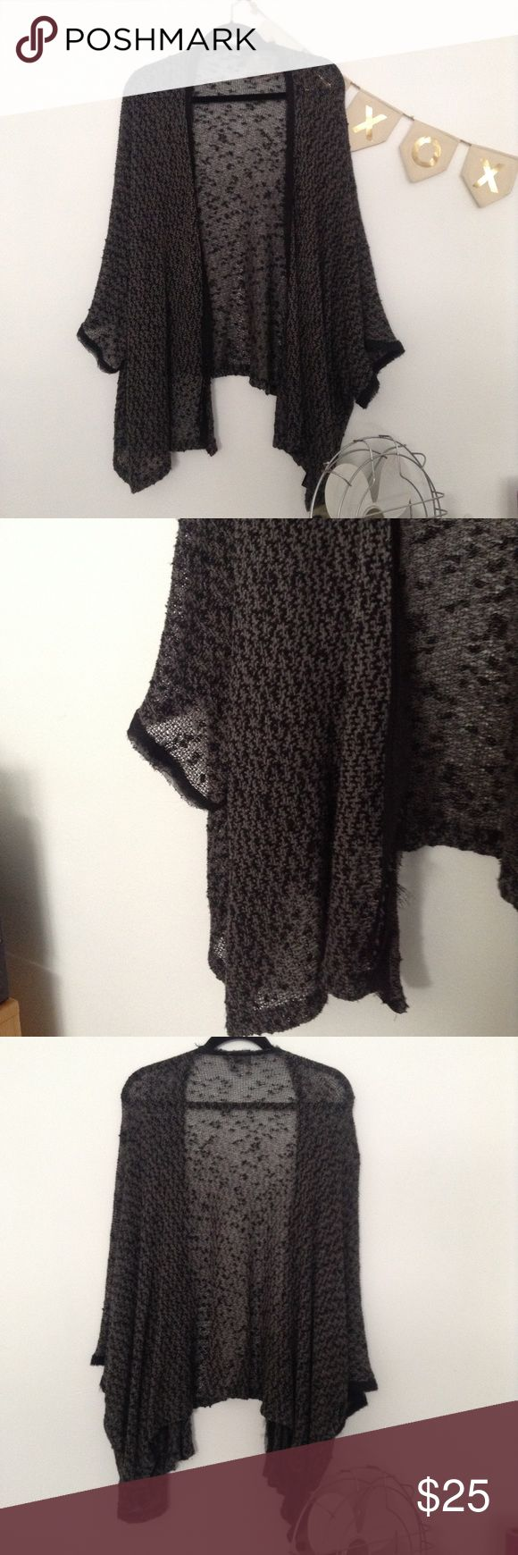 UO Sparkle and Fade Black & Grey Shrug UO Sparkle and Fade Black & Grey Shrug. Size XS. Amazing condition. No snags, holes, stains or smells. 68% poly, 28% rayon, 4% spandex. Let me know if you have any questions. Thank you! Urban Outfitters Sweaters Shrugs & Ponchos