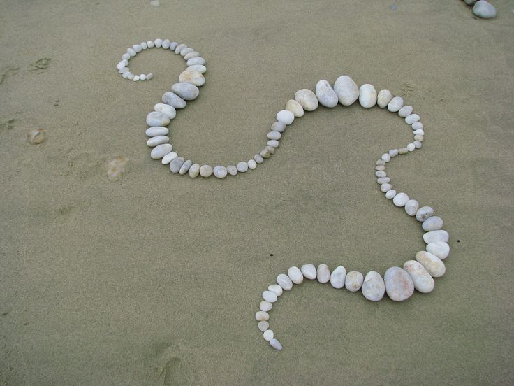 https://flic.kr/p/8KGoxU | Pebble pattern | Quartz pebble arrangement I made on Pebbly Beach, south of Port Douglas, when I lived in the far north of Queensland.