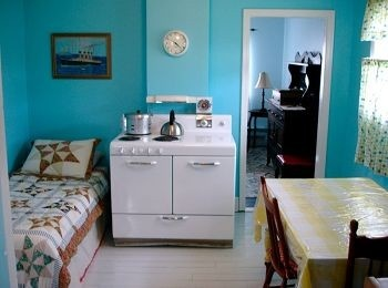 I have always loved the couch/bed in the kitchen that you see in old-style Newfoundland kitchens.