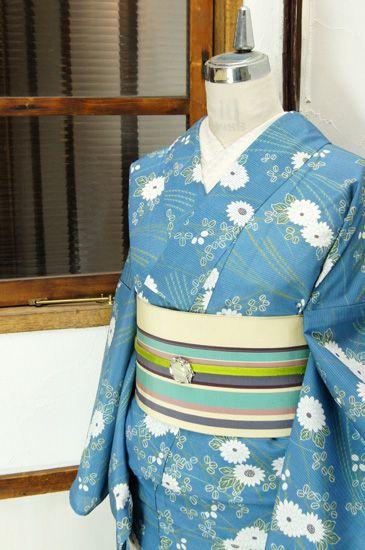 優しい水色の地に、萩や菊花、尾花などの秋の花野が浮かび上がる涼やかな絽の化繊夏着物です。#kimono