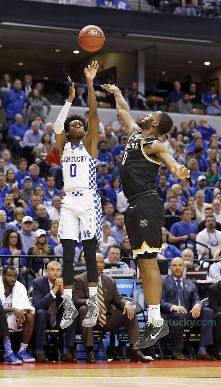 Kentucky Wildcats guard De'Aaron Fox (0) hit jumper in front of Wichita State Shockers forward Rashard Kelly (0) as the University of Kentucky played Wichita State in the second round of the NCAA tournament in Bankers Life Fieldhouse in Indianapolis, In., Sunday, March 19, 2017. This is second half action. UK won 65-62.