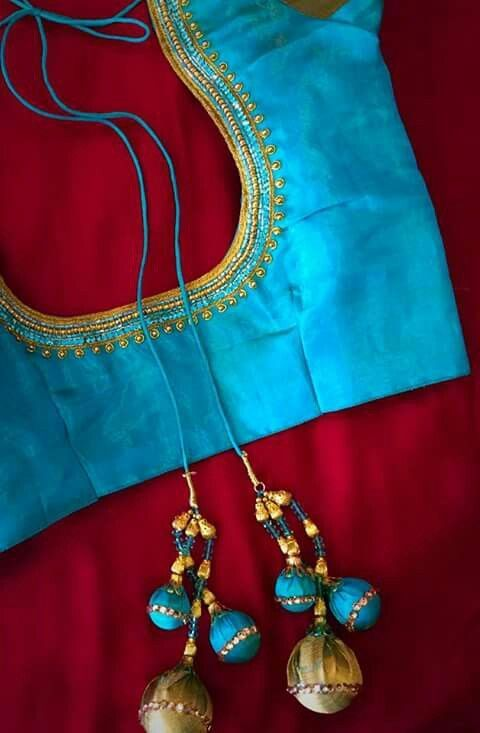 51.Simple blue blouse with three line maggam work