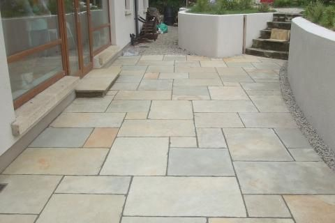 Limestone Patio With Flower Bed, project photos from paving company, genius garden improvements for patios/paving services
