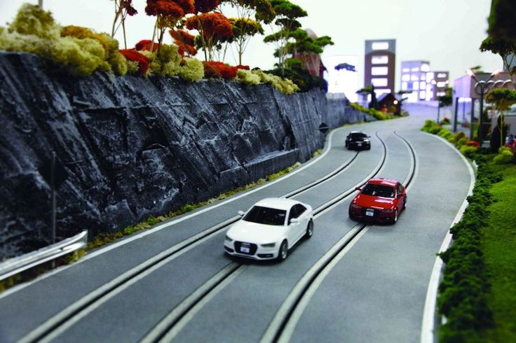 Custom Audi Quattro slot cars (all-wheel driven) with onboard cameras - controlled via iPad