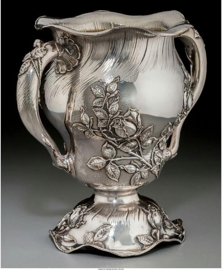 A Meriden Britannia Co. Parcel-Gilt Silver Martelé-Style Two-Handled Vase, Meriden, Connecticut, circa 1895 Marks: (M-eagle), STERLING, 777, 6 PTS 10-1/4 inches (26.0 cm) 54.69 troy ounces.