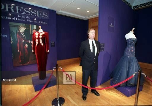 Princess Diana's Dresses: A Christie's security guard stands in front of a long evening dress and tail coat of burgandy velvet, with an embroidered front, by Catherine Walker (left), worn by, Diana, Princess of Wales in Korea in 1992 and a strapless blue tulle evening dress, by Murray Arbeid, whic was worn by her 1986 to a party for King Constantine of Greece. The dresses are part of a collection of 80 ballgowns belonging to the princess that will go under the hammer at Christie's June…