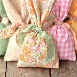 Learn how to make these no sew favor bags using upcycled fabrics.