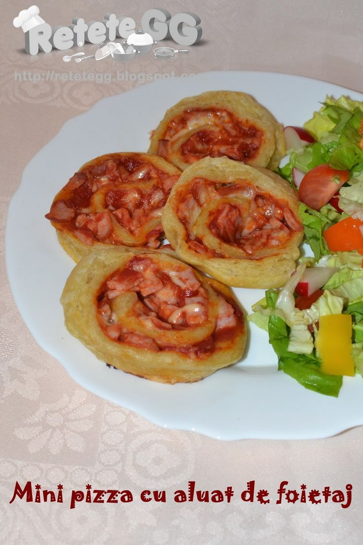 http://retetegg.blogspot.ro/2015/02/mini-pizza-cu-aluat-de-foietaj.html