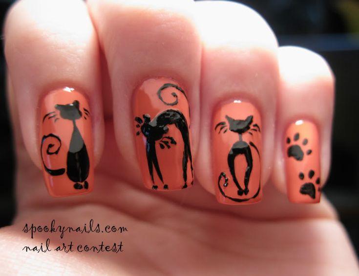 Black cats on orange nails