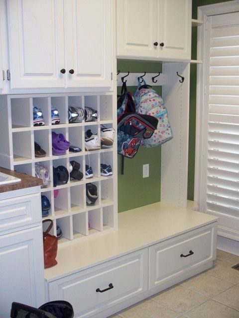 California Closets Mud Room With Raised-Panel Doors And Shoe Cubbies