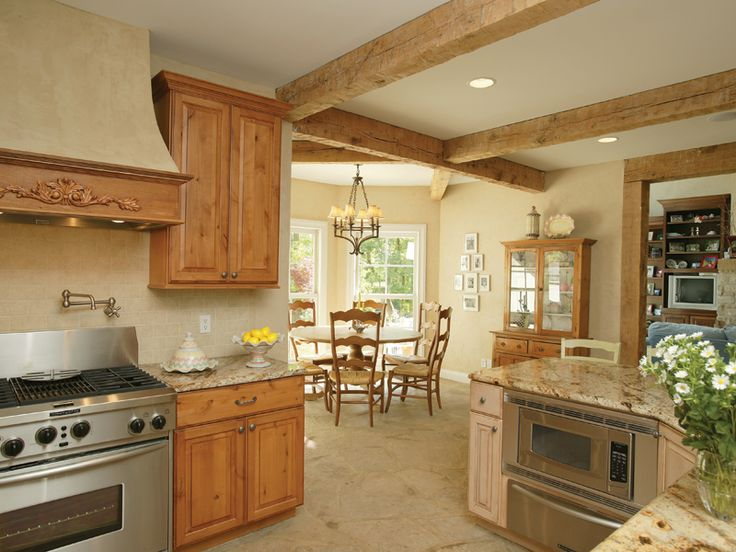 kitchen ceilings with beams | floor, wood ceiling beams and honey-stained cabinetry create a kitchen ...