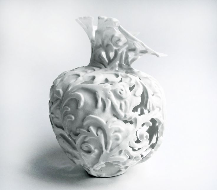 london-based ceramist tamsin van essen has designed a collection of vases influenced from 17th century dutch vanitas paintings, capturing the moment of decay. the deterioration detail from the vessels are expressed through reference of the decline in beauty. by using an etching tool to remove material from the slip cast porcelain forms and a sandblaster in its bisqued state, the decoration becomes part of the ceramic structure. during the last kiln firing, areas of the vases begin to peel.