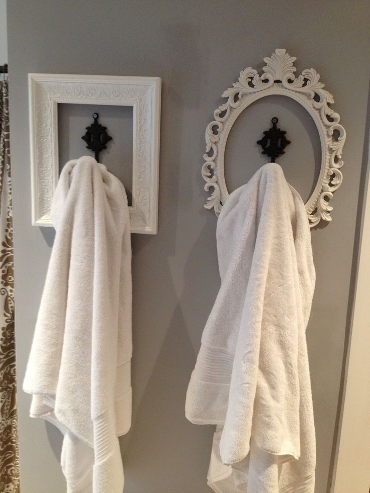 Get cheap picture frames from the thrift store, spray paint them to match your bathroom and now you have cute towel hooks to add character to your bathroom!