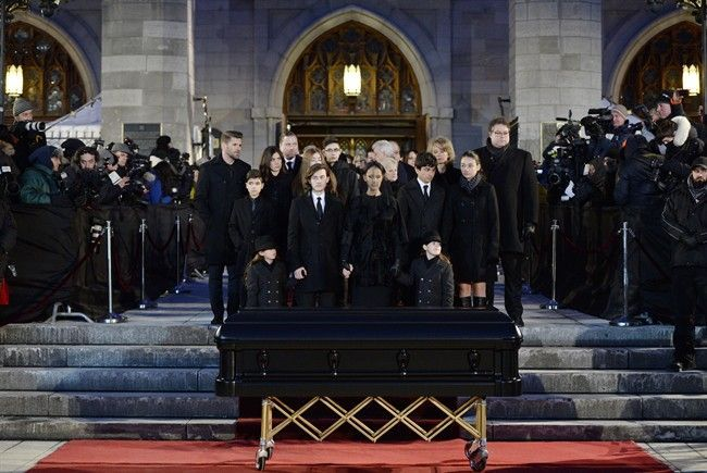 Celine Dion, with sons Eddy and Nelson, and Rene-Charles Angelil, stand before her late husband Rene Angelil' casket at Montreal's Notre-Dame Basilica on Friday, January 22, 2016. Rene Angelil who died of throat cancer last week at the age of 73.