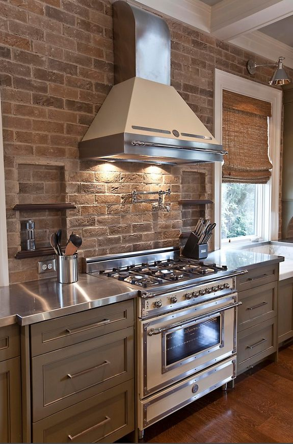 Kinda like the stainless counter tops....    Bertazzoni Gas Stove and Range Hood--I really like the faucet over the stove, too.