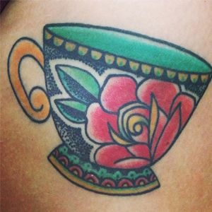 """American Traditional style teacup tattoo - I would like to get something like this along with the saying """"She's whiskey in a teacup."""" The teacup would have to be tilted and look like it is full of whiskey."""