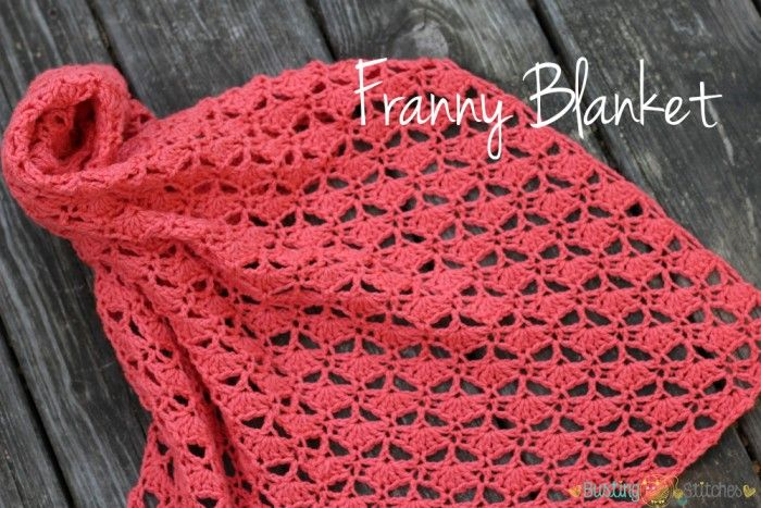 Crochet blanket on the floor.