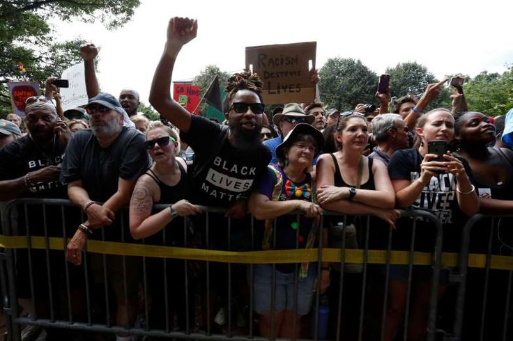 July 8, 2017  -  Ku Klux Klan rally in Virginia:     Counter-protesters shout at members of the Ku Klux Klan, who are rallying in opposition to city proposals to remove or make changes to Confederate monuments, in Charlottesville.