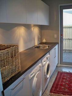 I love the counter on too of the washer and dryer, I don't need the sink and I think the counter should stop there and too off to give you space to long items. But a great concept!