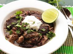 The pressure cooker is an amazing device for making flavor-packed stews in very short order. In this version, black beans are stewed together with spicy Hatch chilies, smoky Andouille sausage, and fall-off-the-bone tender chicken legs. It all cooks in under an hour start-to-finish.