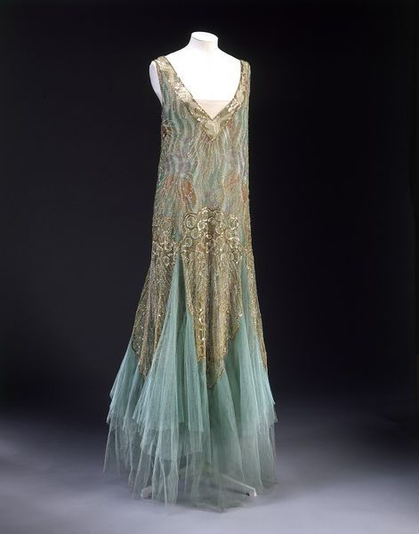 Floating Jean-Charles Worth gown, ca. 1928-1929.    Materials and Techniques:  Printed chiffon, sequins, tulle, partly embroidered, charmeuse, net, lace, crêpe