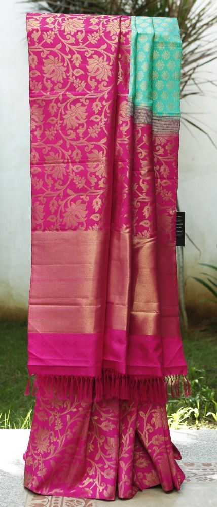 A grand Kanchivaram in a striking pink and blue combination. This half and half saree has a beautiful zari weave all over the body and pallu