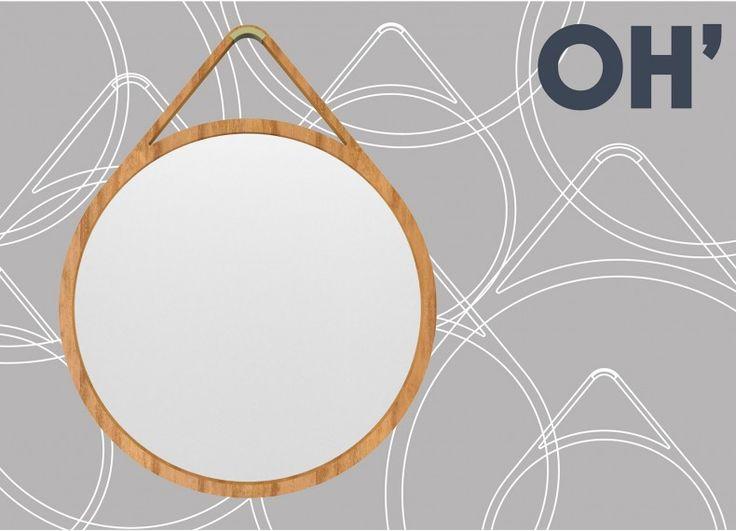 """OH' e' un progetto che """"rivisita"""" i tradizionali specchi da parete circolari con la cinghia. Un oggetto disegnato in maniera pulita ed essenziale, proposto nei colori """"base"""" laccato bianco, grigio e nero o in essenza naturale, viene appeso al muro mediante un gancio metallico colorato."""